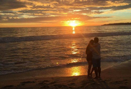Trip Achiever Jennifer Ky with her Husband Enjoying the Sunset